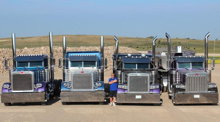 Lorne Pictured with Four Peterbilt Daycabs & One Belly Dump Trailer