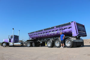 Lorne Pictured with Purple Peterbilt & Tridem Trailer Highlighting 40 Years of Excellence-Rear
