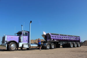 Lorne Pictured with Purple Peterbilt & Tridem Trailer Highlighting 40 Years of Excellence-Side