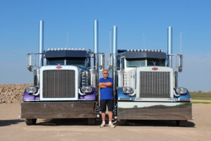 Lorne Pictured with Two Custom Peterbilt Daycabs