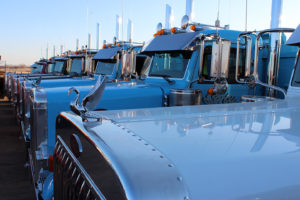 Serbu Sand & Gravel Ltd. Peterbilt Teal Fleet Side Profile