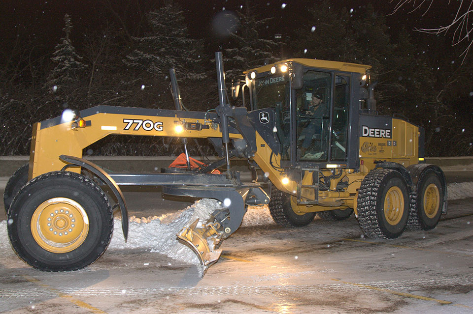 Snow removal for commercial properties require larger heavy equipment like motor graders.