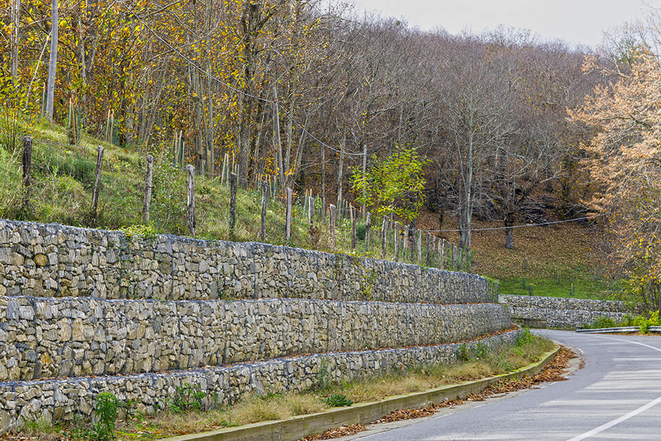 Retaining wall built with gabions filled with gabion stones.