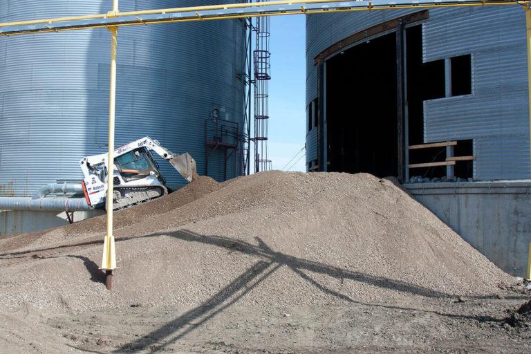 Skid steer building a gravel ramp atFWS site.