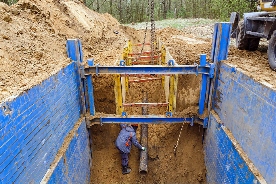 Supporting trench walls to improve excavation safety.