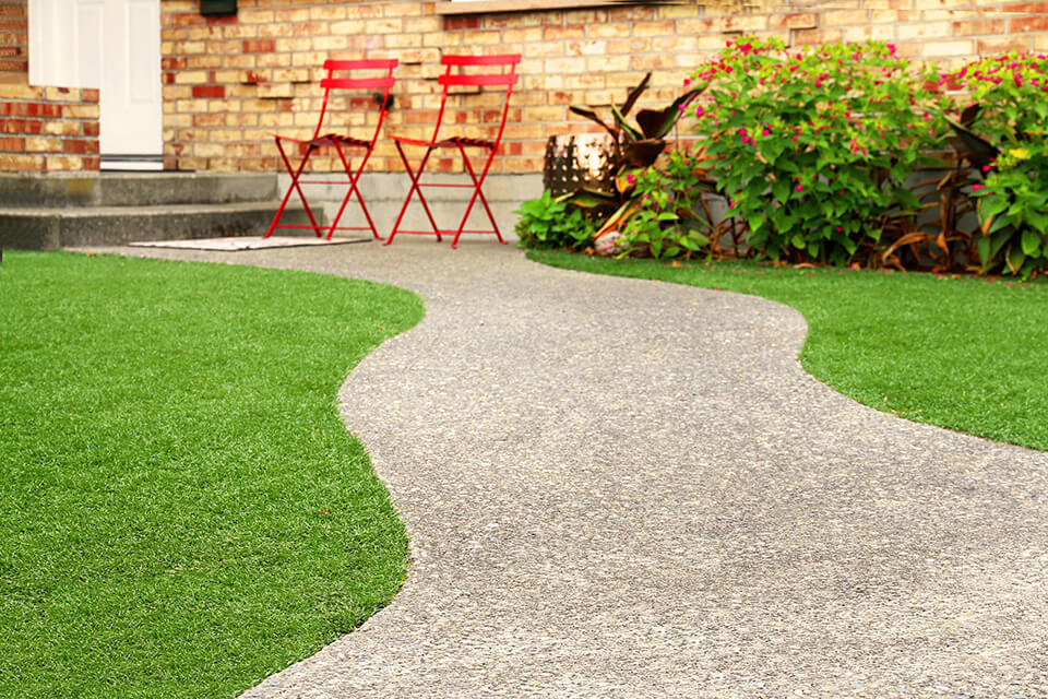 Artificial grass and gravel walkway.