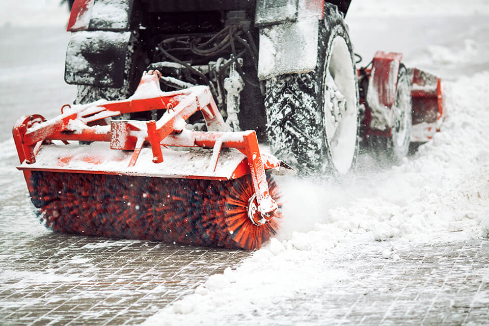 Snow brush machine clearing snow.