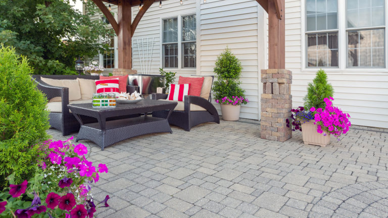 Small paved patio with furniture.