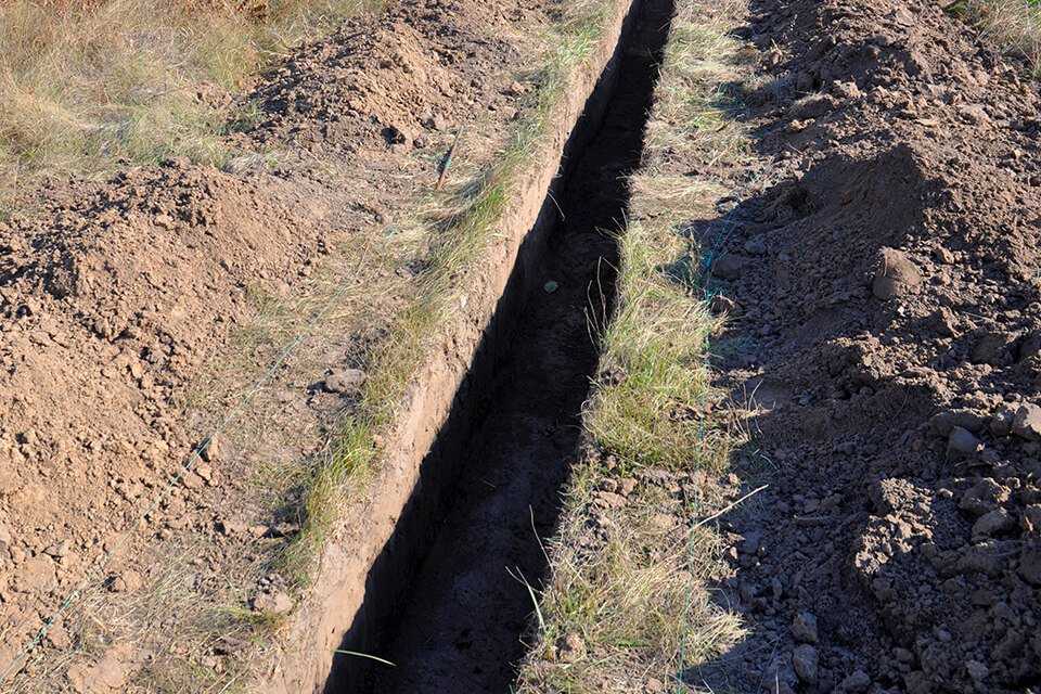 A trench ready to be backfilled with fill dirt or PG&E sand.